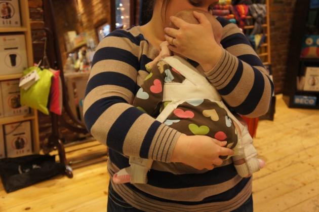 babywearing in a plavik harness