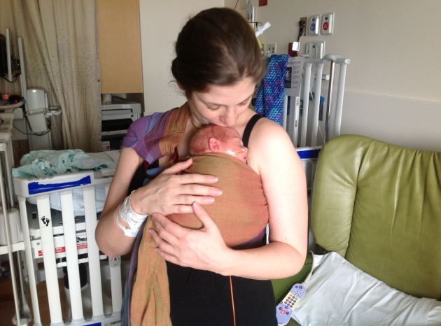 In between the NICU cycle of tests. feedings, naps, and diapers, Babywearing can help draw some of the normalcy back into the post partum period with twins in a medical environment