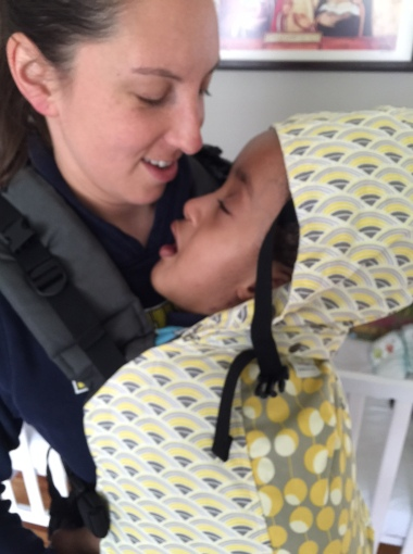 He did indeed have his first on mommy carrier nap that day, a huge milestone!!!