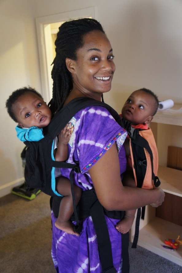 twin girls 9 months adjusted in a twingo baby carrier
